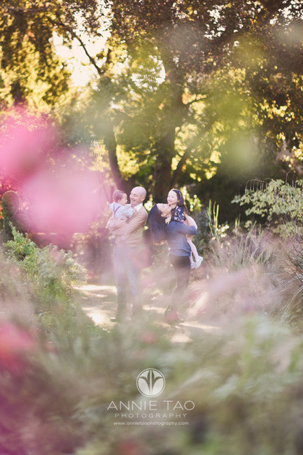 Bay-Area-lifestyle-family-photography-family-hugging-in-garden-behind-flowers