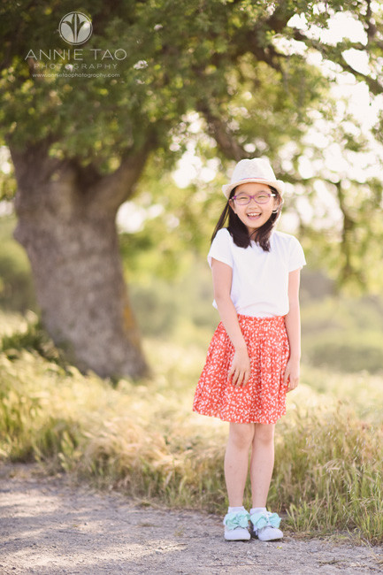 east-bay-lifestyle-children-photography-girl-with-hat-and-coral-skirt-giggling