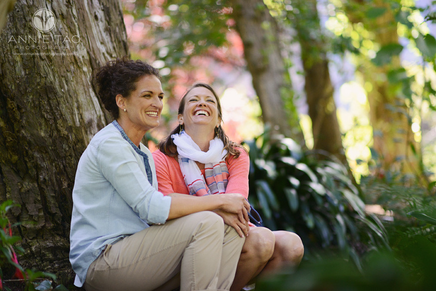 San-Francisco-wedding-photography-gay-wedding-brides-laughing-and-sitting-in-a-jungle