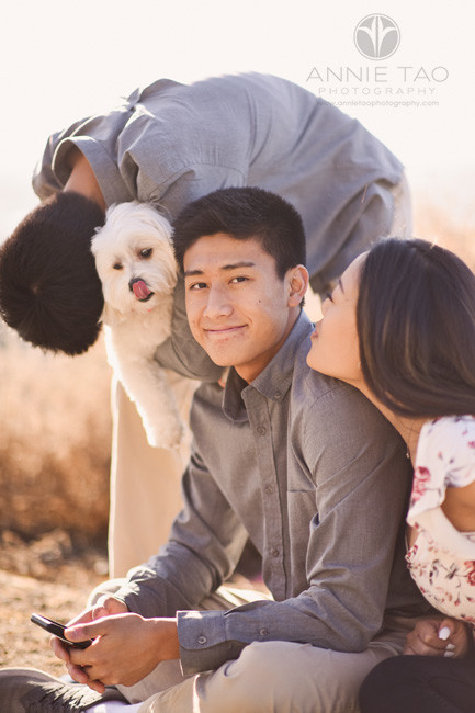 South-Bay-lifestyle-teen-young-adult-photography-sister-and-fur-brother-kissing-adult-sibling