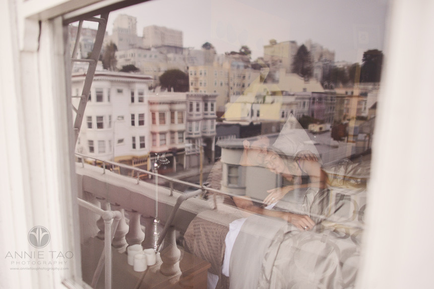 San-Francisco-couple-lifestyle-photography-man-and-woman-snuggling-in-bed-view-from-window-with-cityview-reflection