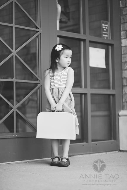East-Bay-styled-children-photography-preschool-girl-standing-by-door-with-suitcase-BxW