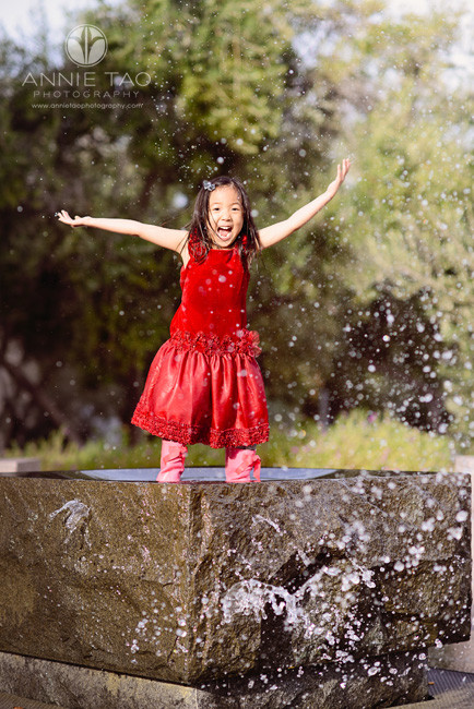Bay-Area-Palo-Alto-lifestyle-family-photography-young-girl-in-red-playing-in-fountain