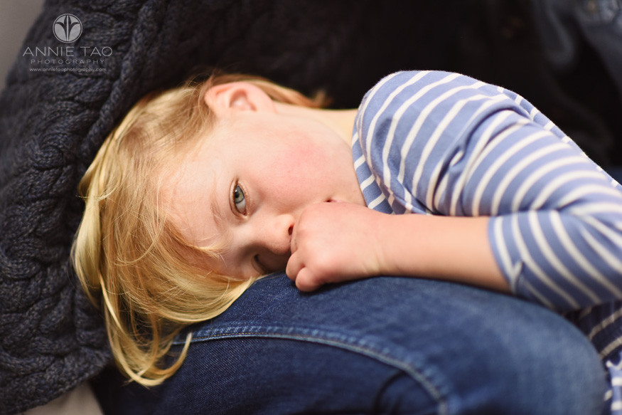 San-Francisco-lifestyle-children-photography-preschool-girl-with-grey-eyes-trying-to-nap-on-moms-lap-closeup