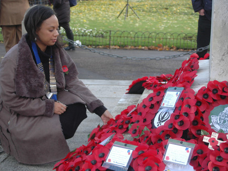 Lion President Madelaine Gamble placing a wreath on the Bedford War Memorial.