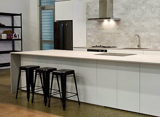 White modern Poly studio kitchen with st
