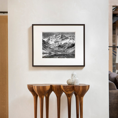 A transitional space is transformed into a gallery by placement of artwork of the highest quality and sophistication
