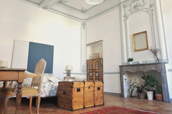 Bedroom with original moldings, high ceilings, old fireplaces and antiques