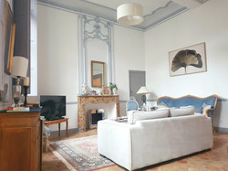 Comfortable living room with original moldings, tiles and high ceilings in an Hôtel particulier in A