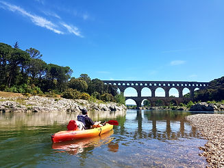 Exploring the Pont du Gard on a canoe