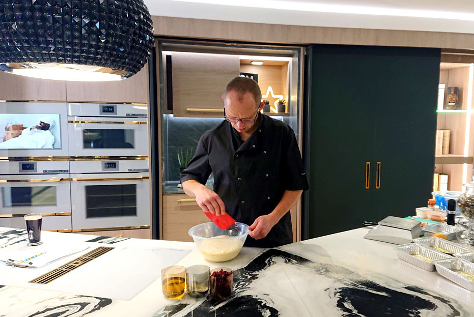 Paul from Rugby Read Bread cooking in our latest kitchen room setting