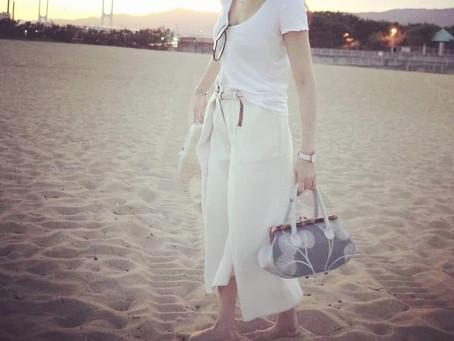 美しい人が持つバッグ