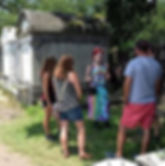 Tour Guide giving small group walking tour of New Orleans Cemetery and Garden District