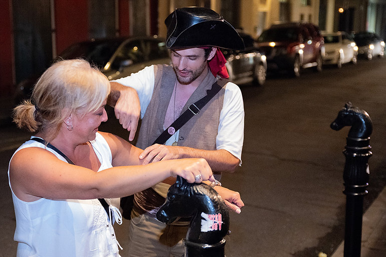 Tour Guide giving small group ghost walking tour of Haunted New Orleans French Quarter