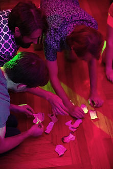Guests solving puzzle at New Orleans Immortal Surreal History Party