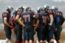 Football Player Huddle
