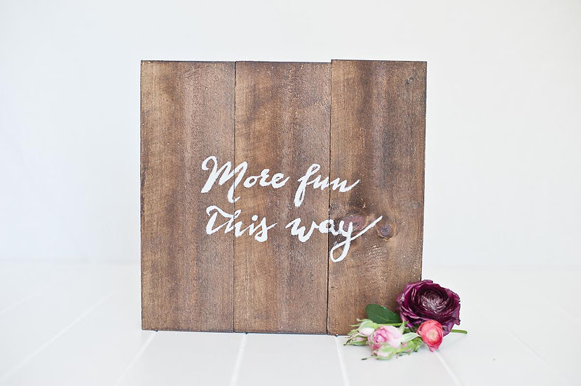 Rustic Wooden Signage with Calligraphy Typography