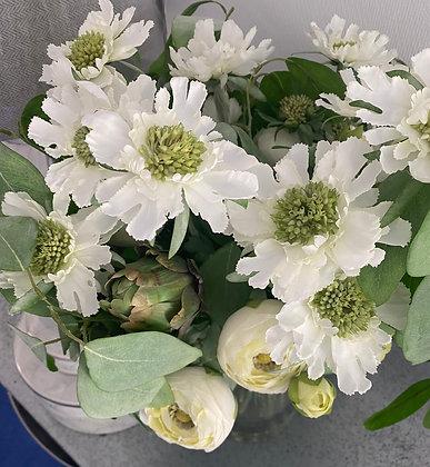 Eucalyptus, ranunculus, Mixed stem arrangement in a  glass vase