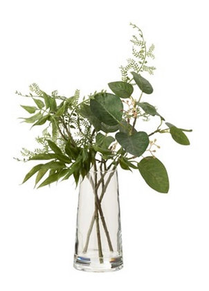 Glass vase with greenery
