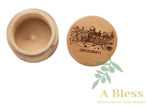 A small  round Jewelry Box engraved on it the city of Jerusalem
