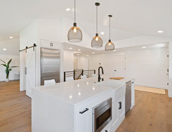 turned on pendant lamps above kitchen is