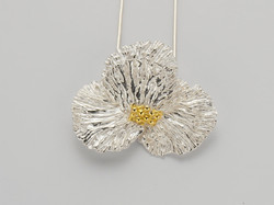silver_flower_with_gold_accents (1).jpg