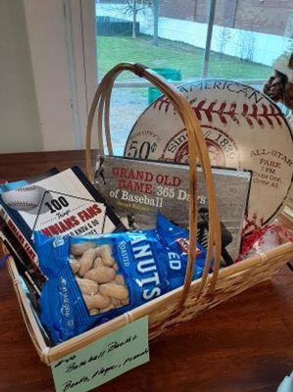 Item #40. Baseball basket. Includes books, a baseball plaque and peanuts.