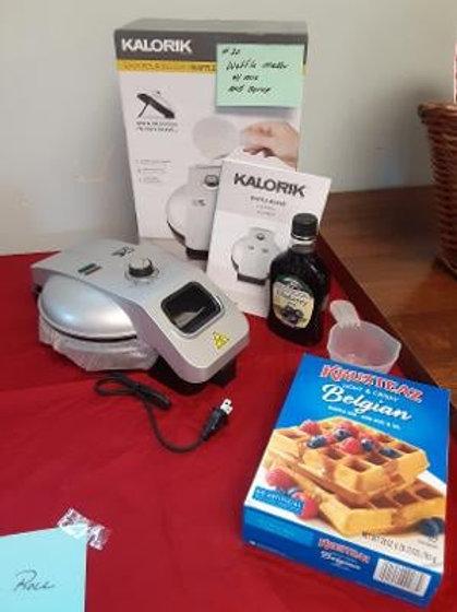 Item #20. Waffle iron (new) plus Belgian waffle mix and blueberry syrup.