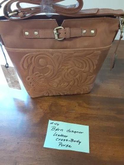 Item #46. Designer cross-body leather purse by Born.