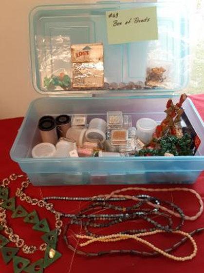 Item #63. Craft box full of beads.