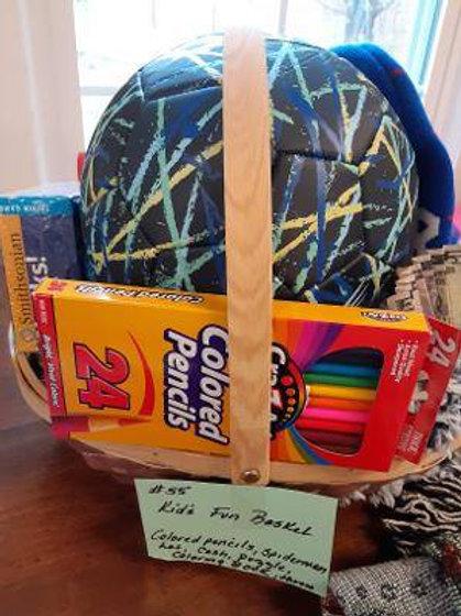 Item #55. Kids fun basket. Includes puzzle, colored pencils, coloring book, cash