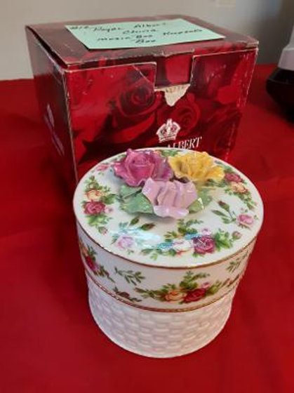 Item #19. Royal Albert china music box/keepsake box.
