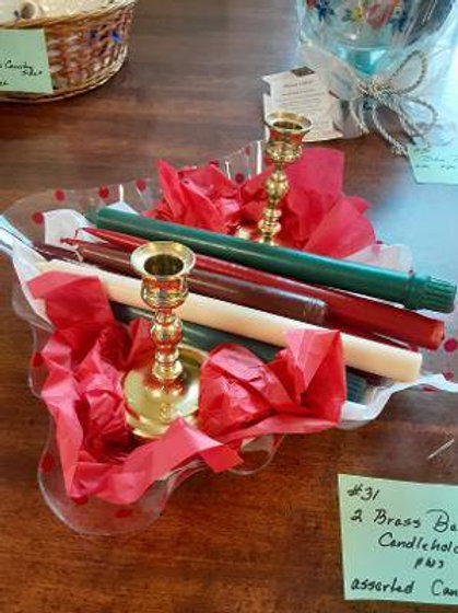 Item #31. Two Baldwin brass candlesticks and assorted candles.