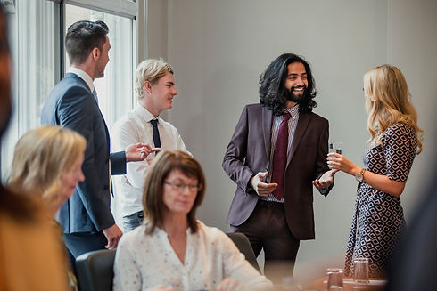 Businessmen and women meeting and greeti