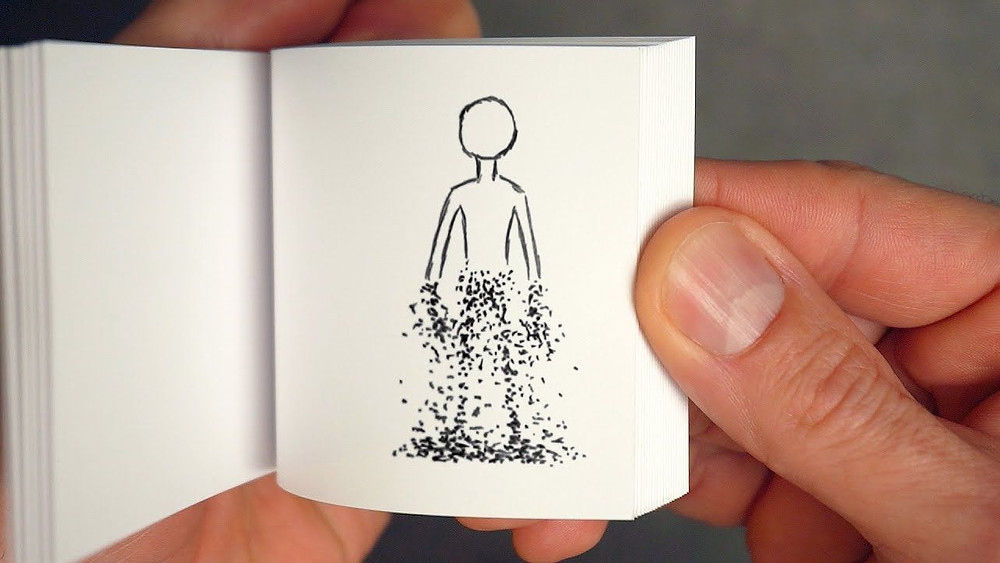 A Thumb flipping through a flip book