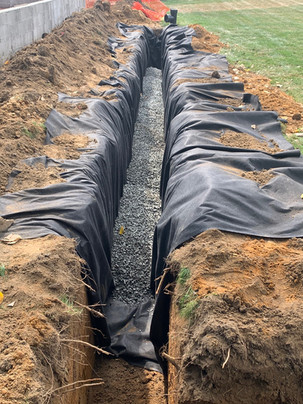 Drainage System Alongside Clay Tennis Court