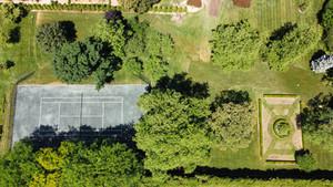 Sodding job alongside clay tennis court, Green