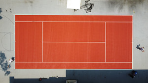 Terra cotta colored tennis court, French Open inspired