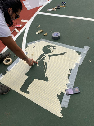 Banksy Stencil on Basketball Court