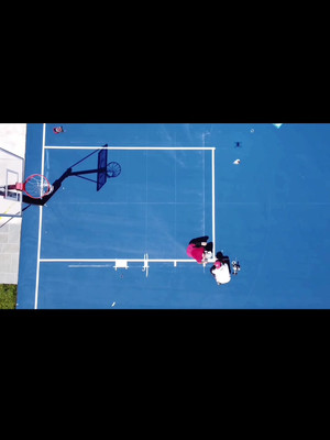 Time lapse of line painting on half court