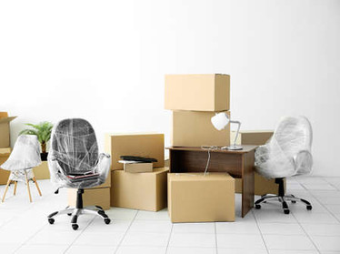 95959948-moving-cardboard-boxes-and-pers
