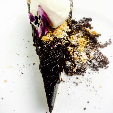 Baked chocolate tart, honeycomb, praline crumb