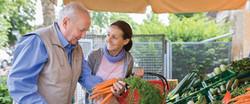 Elderly-man-with-caregiver-shopping_edit