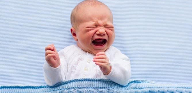 Newborn crying. Cluster feeding. Newborn breastfeeding. Baby awake all night