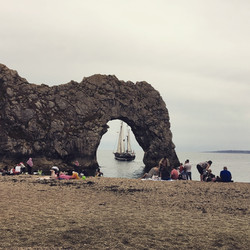 Moonfleet Sailing framed in Durdle Door