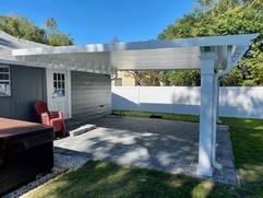 Brad Kriebel - White fixed roof pergola