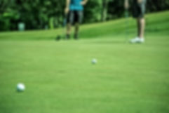 Stunning green, putting golf players