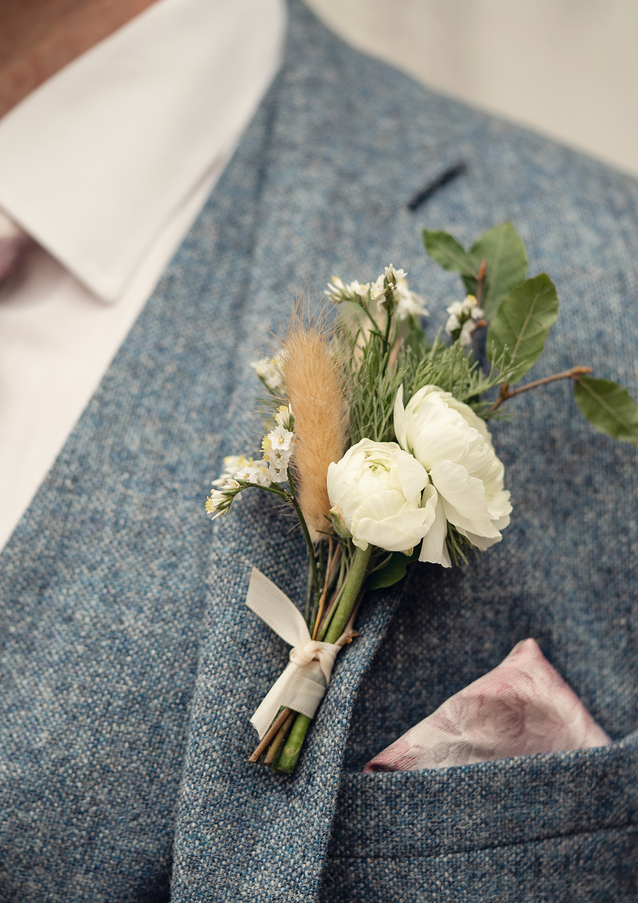 Fresh flower buttonhole with dried bunny tail grasses