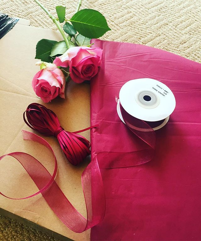 Emma Jane Floral Design lays out packaging, kraft boxes and burgundy tissue and trailing ribbon