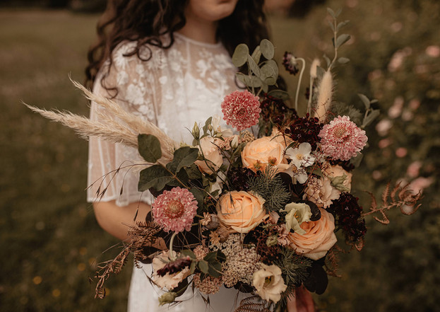Fresh flowers mixed perfectly with dried grasses in this bridal bouquet by Emma Jane Floral Design